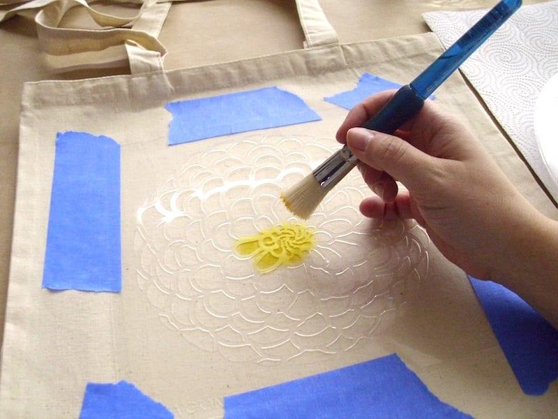 stenciling a tote bag