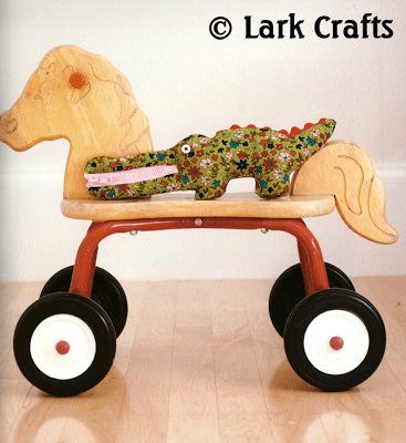 Smiling Crocodile by Laura Wilson, from her book Flip Dolls and Other Toys
