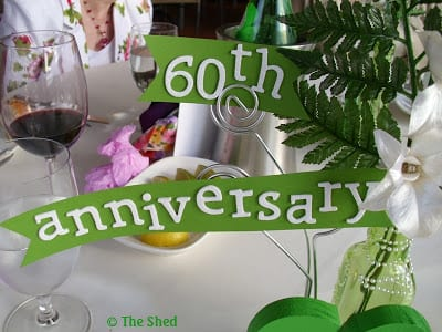 60th anniversary banners easily attached to the photo holders