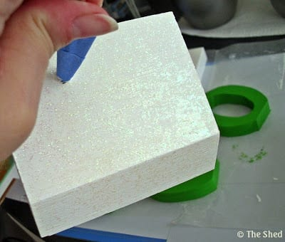 wooden base painted in white paint with a coating over white glitter paint