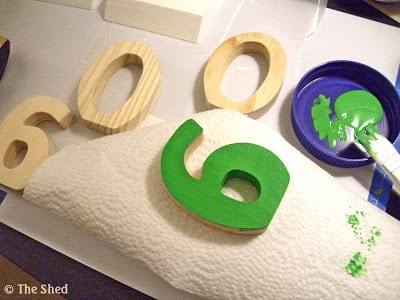 wooden numbers were painted in a Summery green shade
