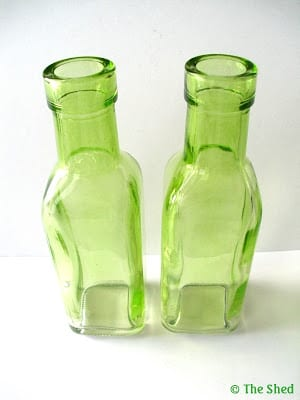 small green glass bottles from the craft store, perfect as bud vases