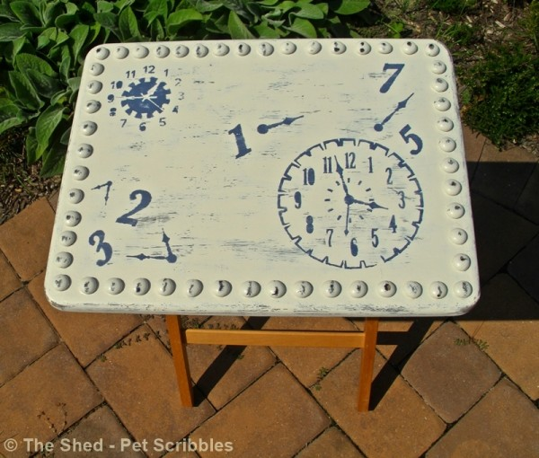 This old tray table got an easy makeover with paint, stencils, and a sanding block!