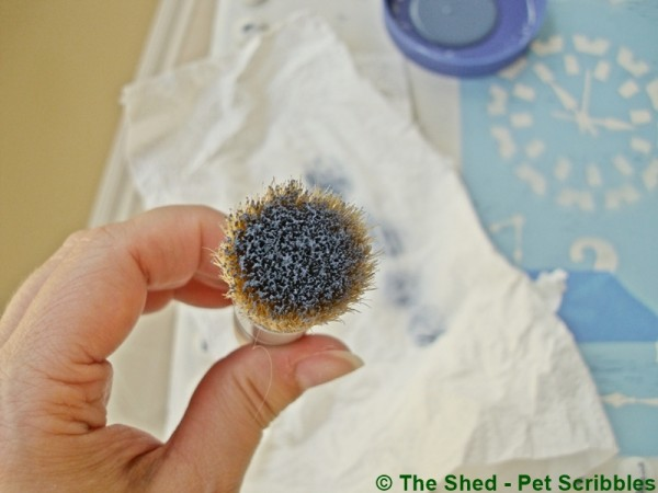 You need very little paint on your stencil brush. Less is more!