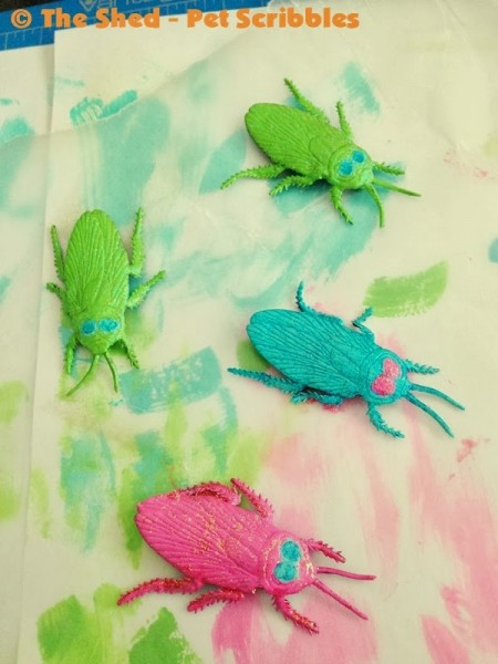 """You can """"pretty up"""" fake rubber bugs for Halloween with glitter paints!"""