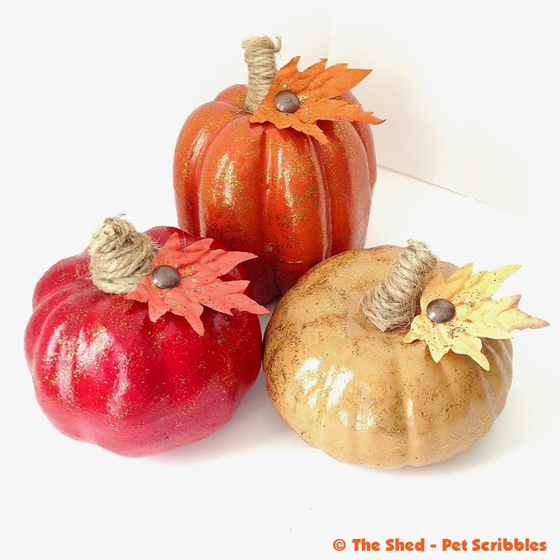 Painted Glittered Pumpkins, with jute twine-wrapped stems and matching faux leaves