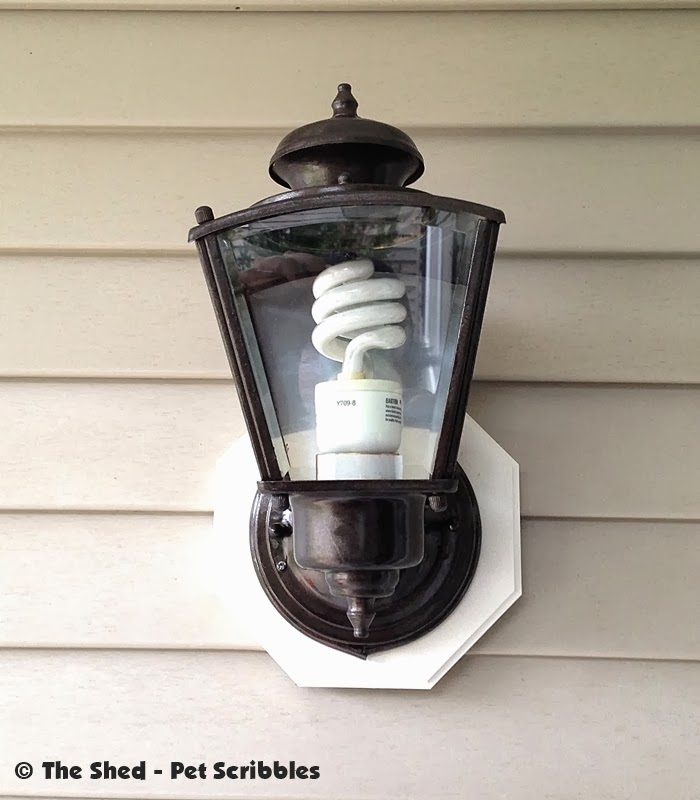 This stylish oil rubbed bronze light fixture was once an ugly rusty brass fixture.