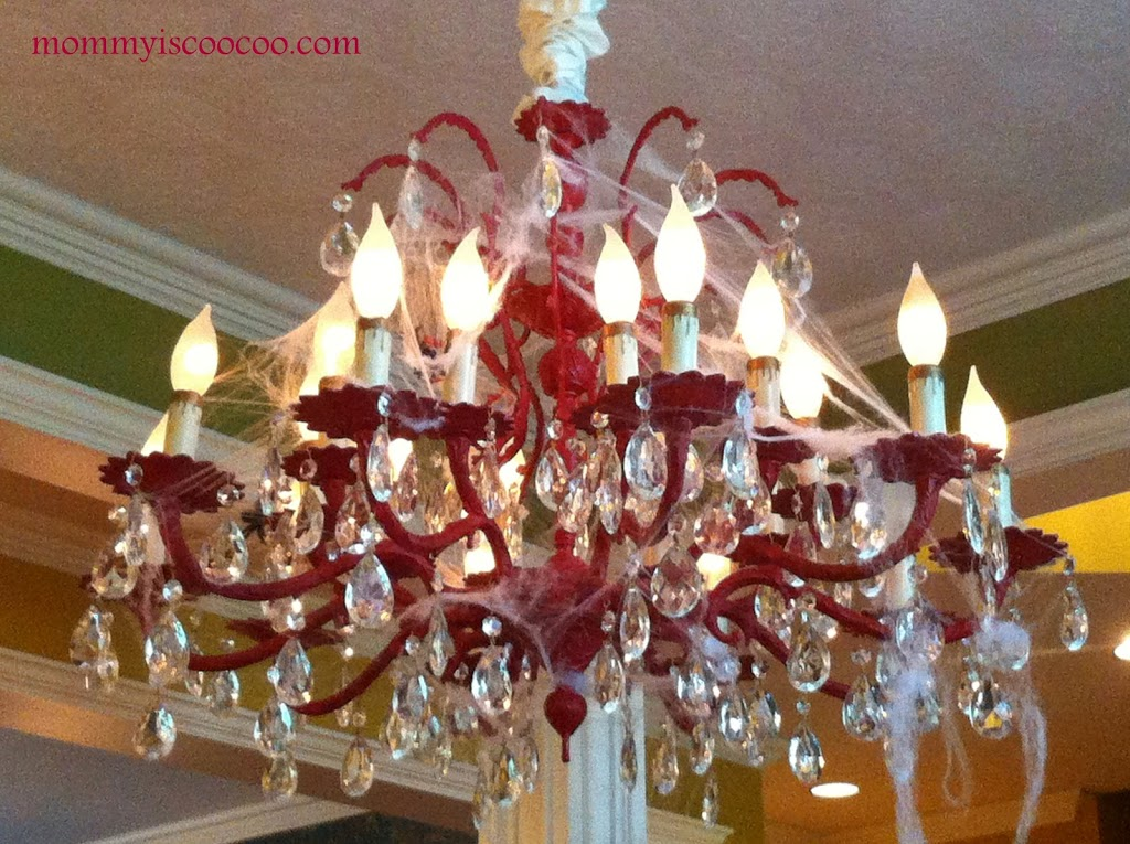 spooky cobweb chandelier ideas from mommy is coocoo i love decorating with cobwebs for halloween