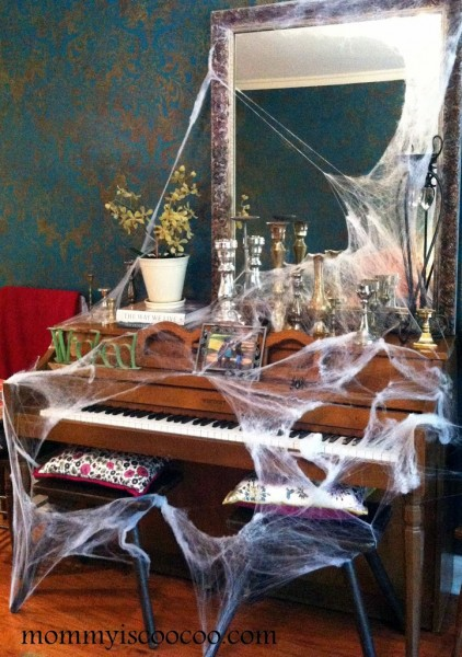 Faux cobwebs are an easy way to decorate for Halloween! via Mommy is Coocoo
