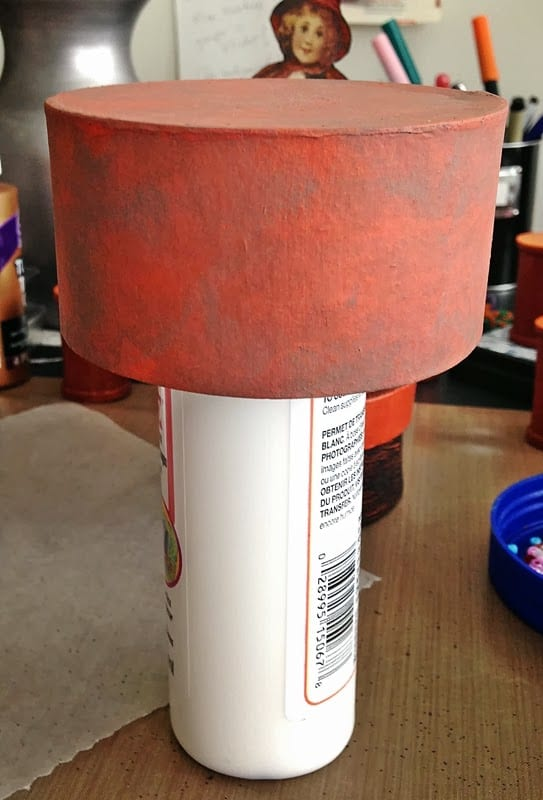 Easy tip for painting paper maché boxes: place box upside down on a bottle. You can paint AND dry the box easily this way.