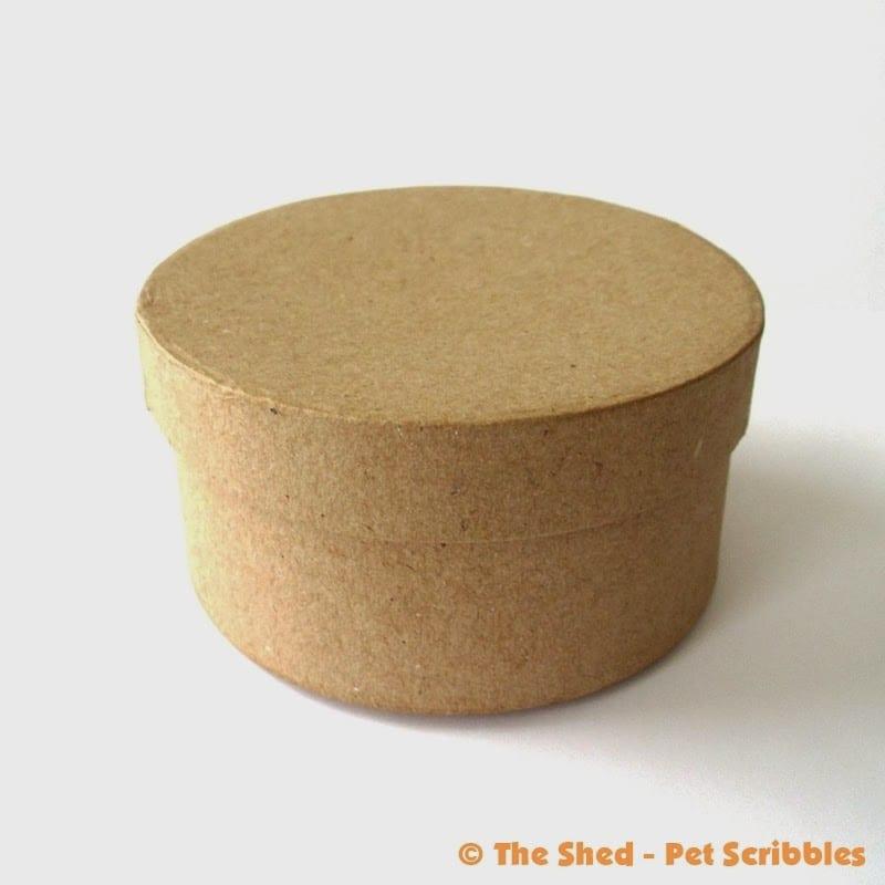 An unfinished paper maché box...
