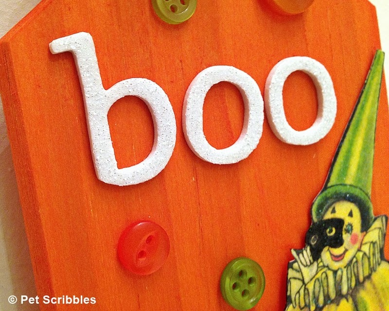 Halloween plaque closeup, using dyed wood, buttons, adhesive letters and a vintage image!