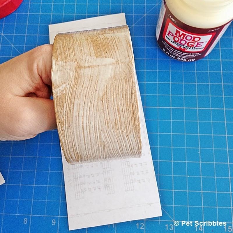 Mod Podge onto paper mache box