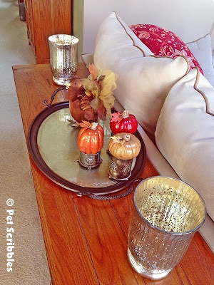a Thanksgiving vignette on the sofa table