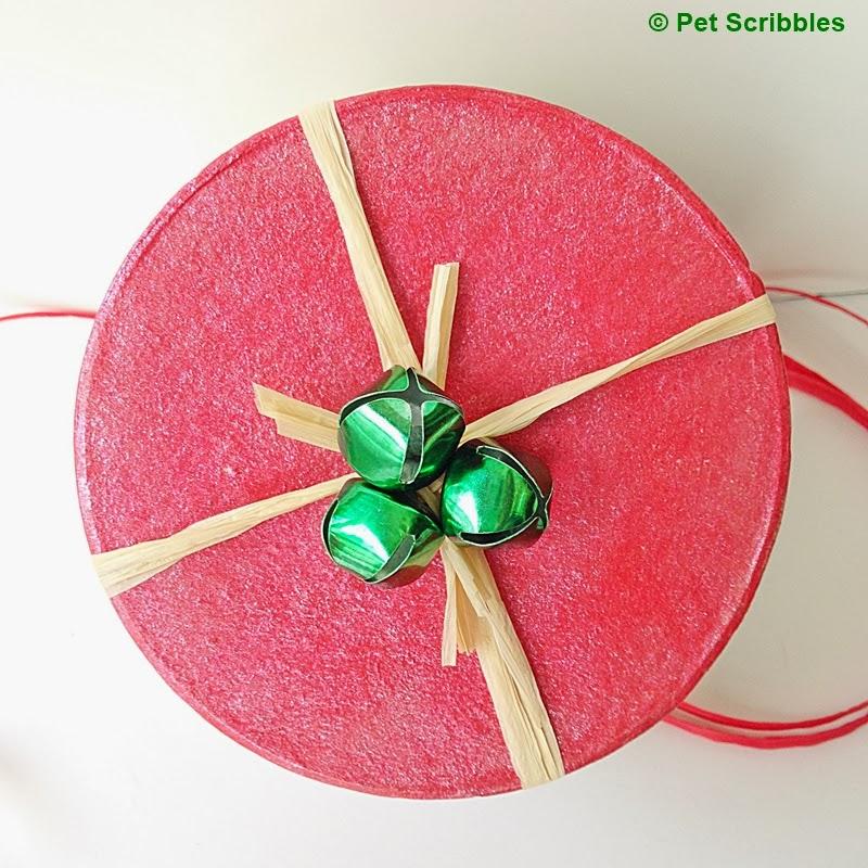 Raffia ribbon and some jingle bells provide a pretty (and simple) embellishment!