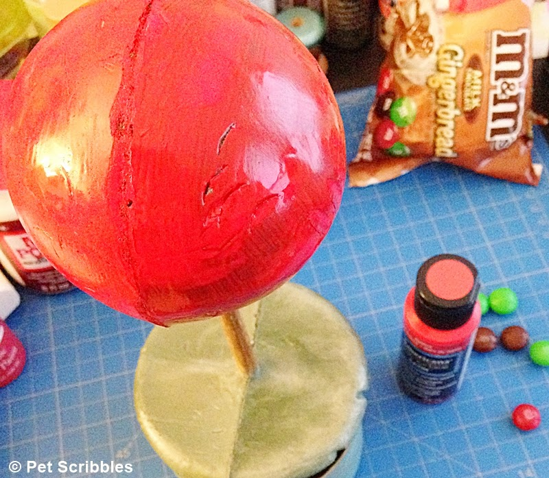 red paint on craft foam topiary (for Holiday M&M Topiary craft)