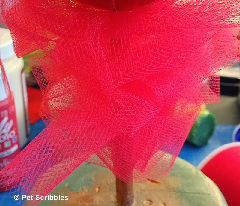 red tulle around M&M topiary stem