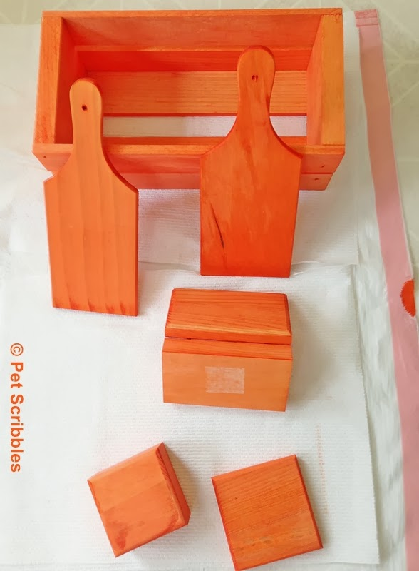 Unfinished wood dyed using Rit Dye in Tangerine, a bright orange color!