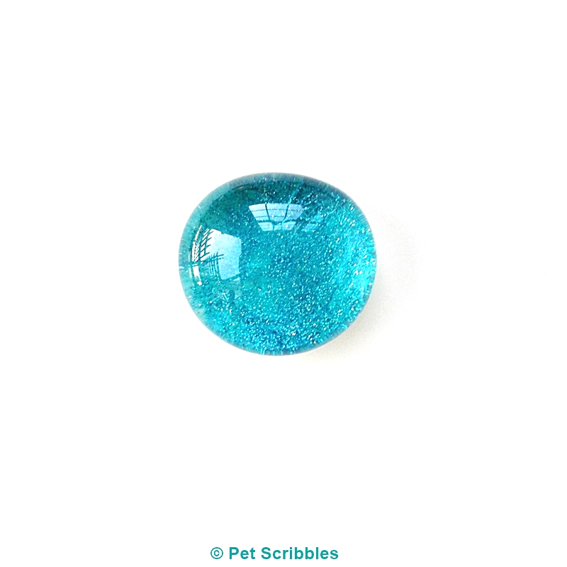 Marble Magnets DIY: close up look at a turquoise glitter marble magnet!
