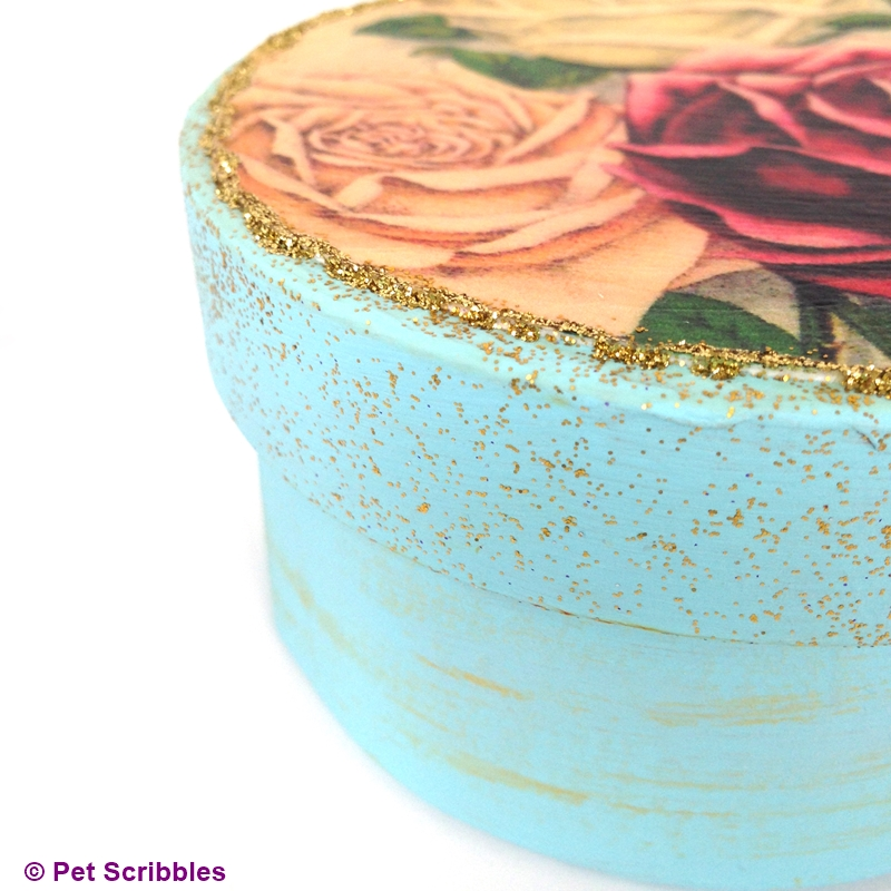 Vintage rose images decoupaged onto a paper maché round box.