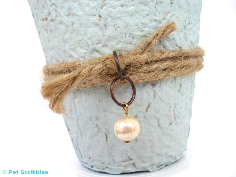 Vintage Peat Pot Wedding Favor - detail shot of pearl embellishment attached with jump rings to twine.