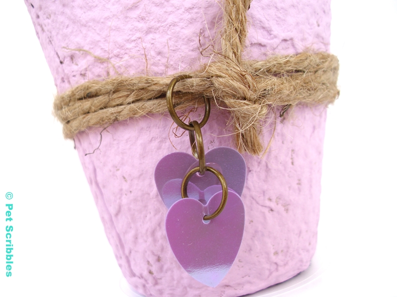 Lavender Peat Pot Wedding Favor - detail shot of heart-shaped sequins attached with jump rings to twine.