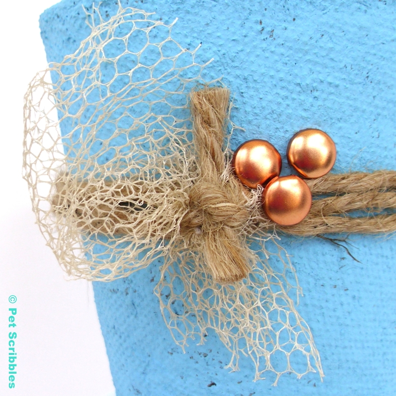 Escape Peat Pot Wedding Favor - detail shot of vintage netting and brads attached to twine.