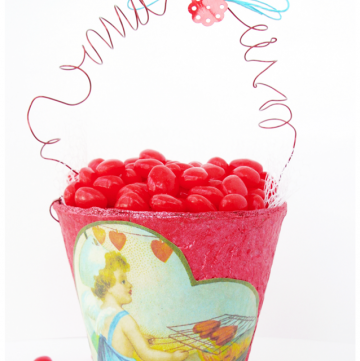 This Red Hot Valentine Container is a sweet, vintage-style gift idea for Valentine's Day. Use Mod Podge and a peat pot for heart-shaped cinnamon candy!