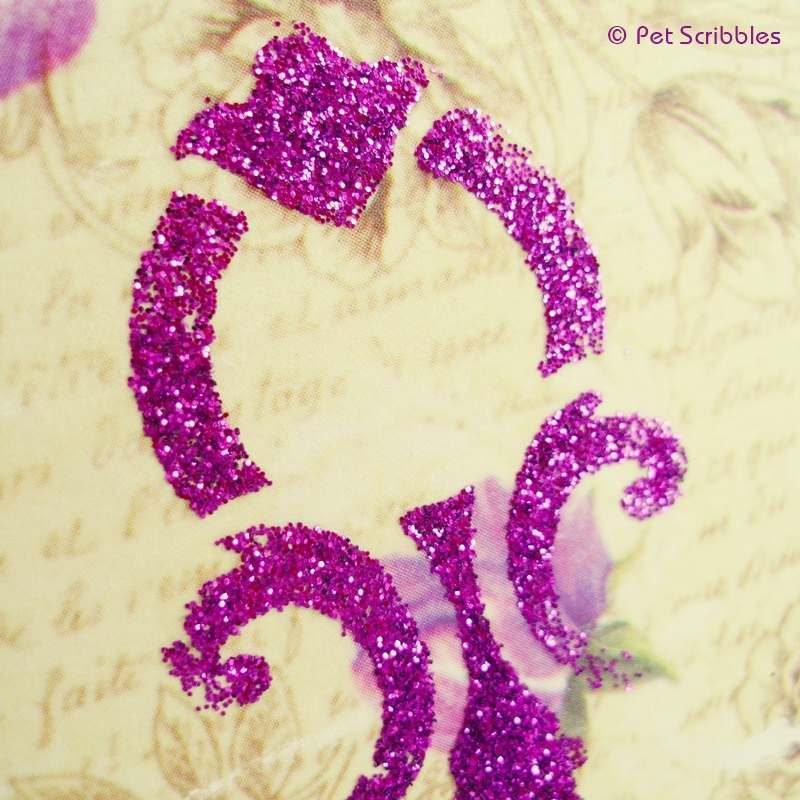 Close up of a glittered stencil design after it has dried and extra glitter is brushed away completely.