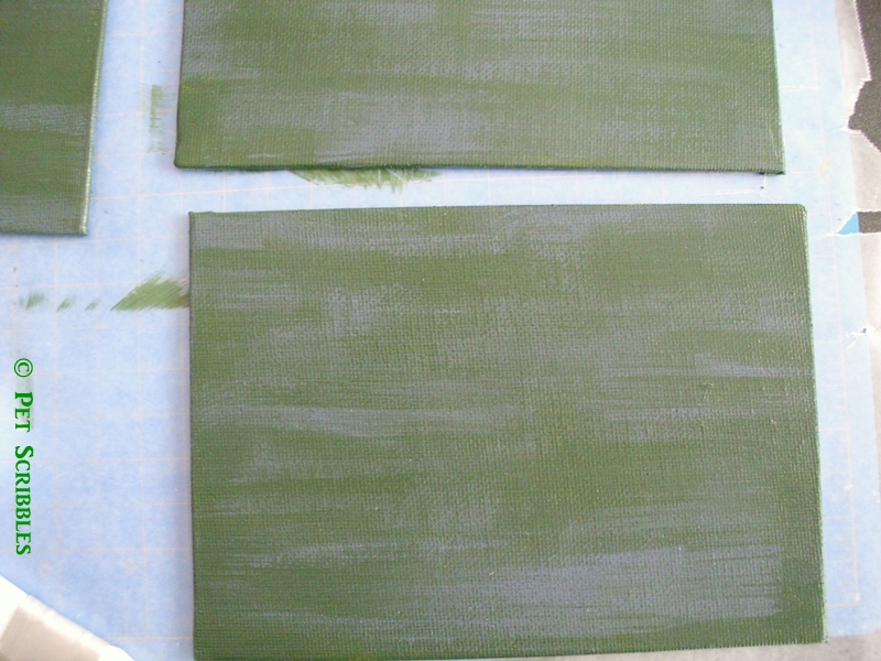Green paint with blue paint brushed on then wiped off using a paper towel.