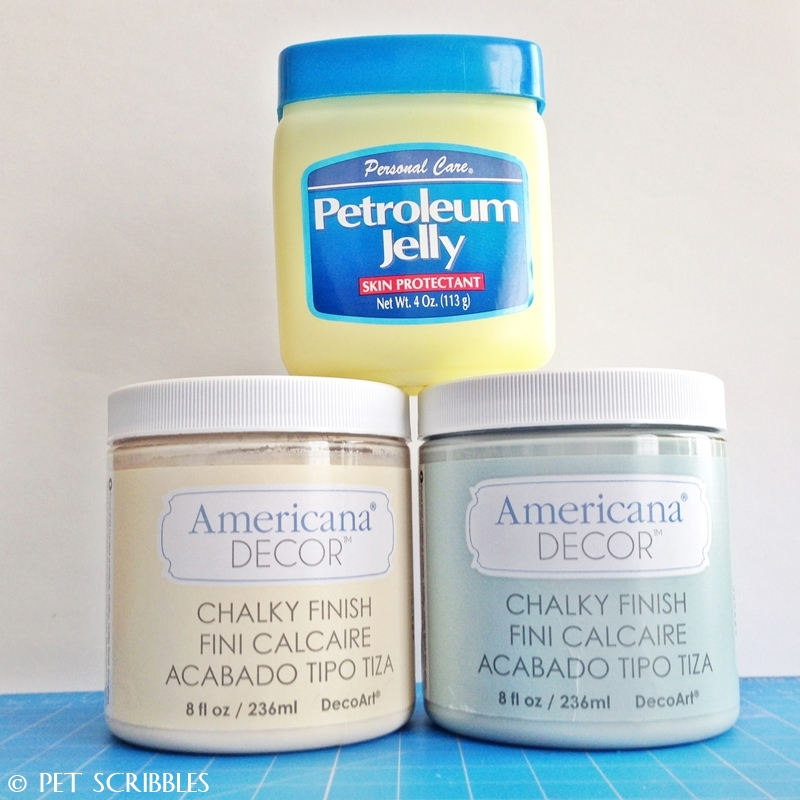Create a chippy paint finish on furniture easily with chalky finish paints and petroleum jelly!