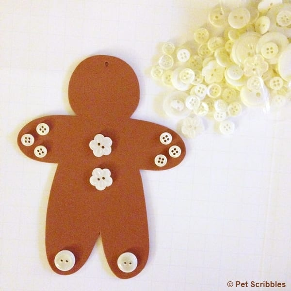 adding buttons to gingerbread men ornaments