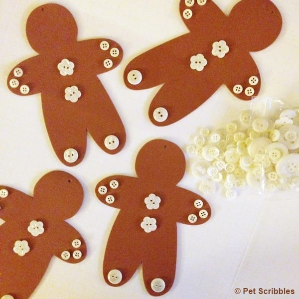 use glue to attach buttons on foam gingerbread men ornaments