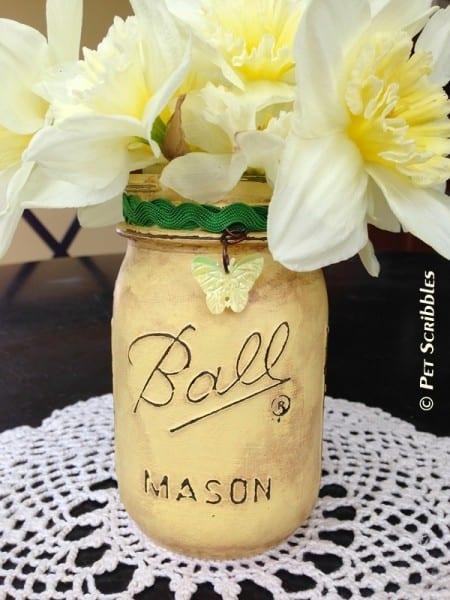 Distressed mason jar vase with flowers