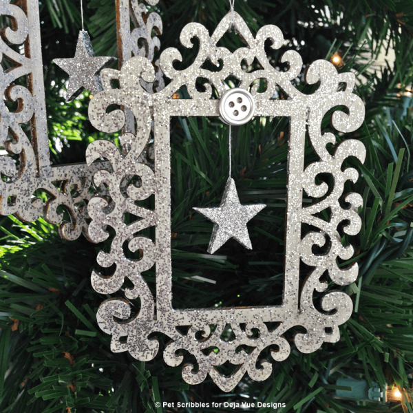 Silver Glitter Ornament with a hanging star inside!
