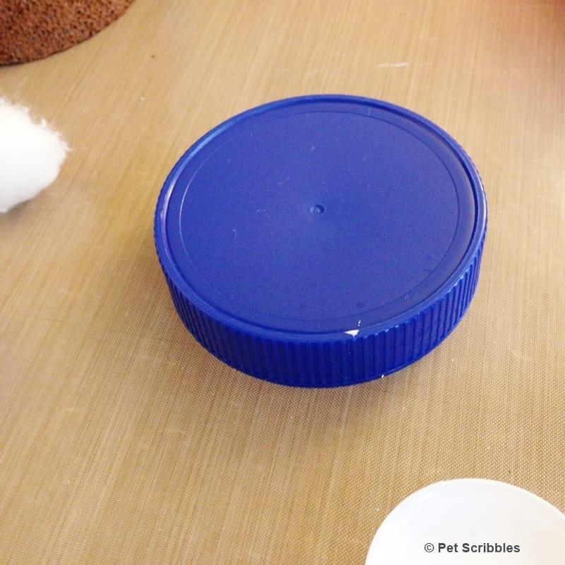 plastic jar lid as crafting pedestal