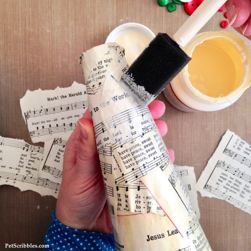 Sheet Music Santa Hat made with a Styrofoam cone, sheet music and Mod Podge!