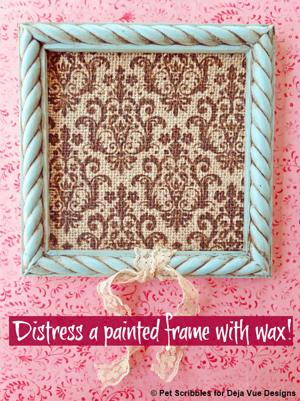 Using my favorite shade of chalky finish paint plus some brown wax, I gave this frame a wonderfully distressed look! I framed a piece of printed burlap, and added a shabby bit of vintage lace seam binding for the finishing touch!