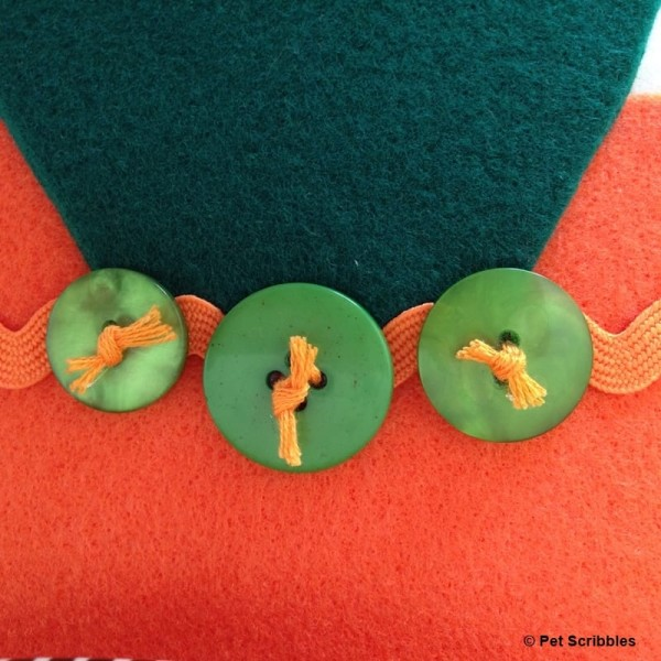 green buttons and orange thread