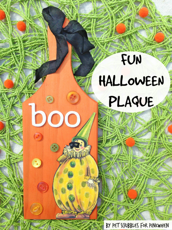 Fun Halloween Plaque using buttons and a vintage image, with the wood paddle dyed instead of painted! The vintage seam binding is the finishing touch!
