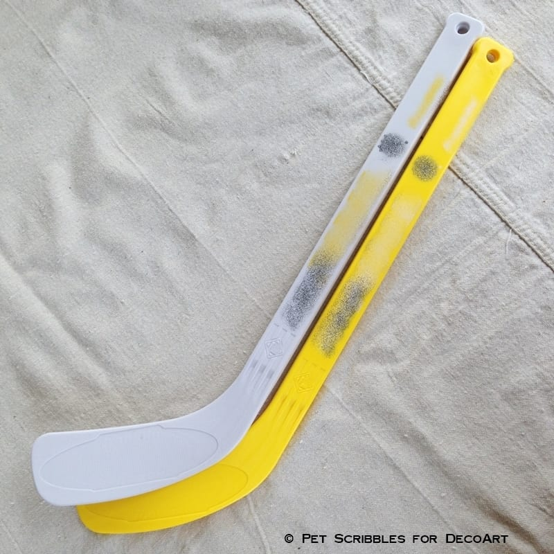 miniature plastic ice hockey sticks