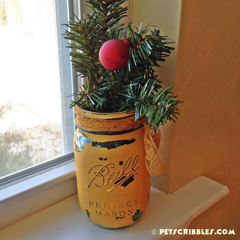 pine garland and distressed painted mason jar