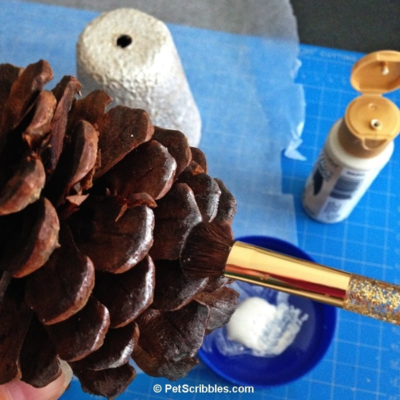 painting the tips of pinecones
