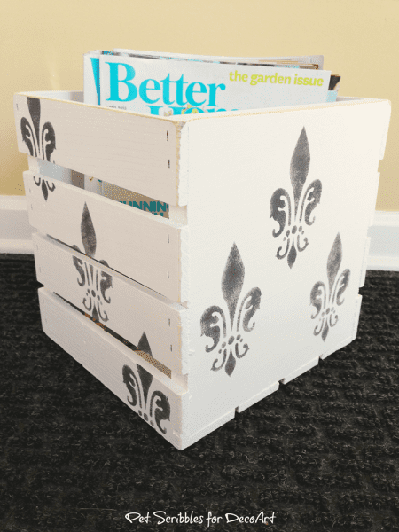 Paint a wooden crate for stylish magazine storage!
