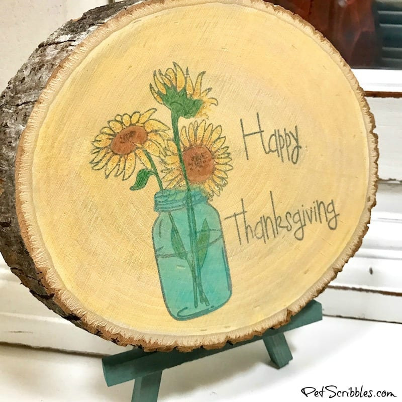 rustic wood slice with sunflowers and mason jar design