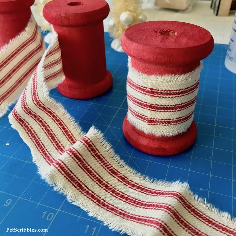 Ivory Bottle Brush Trees on Red Spools