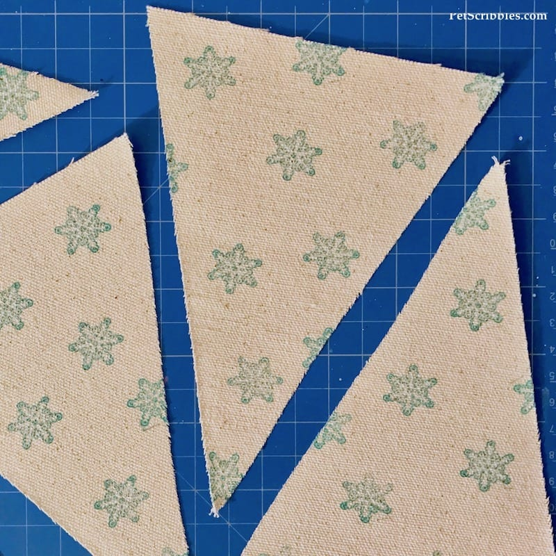 snowflake stamped design on canvas pennants