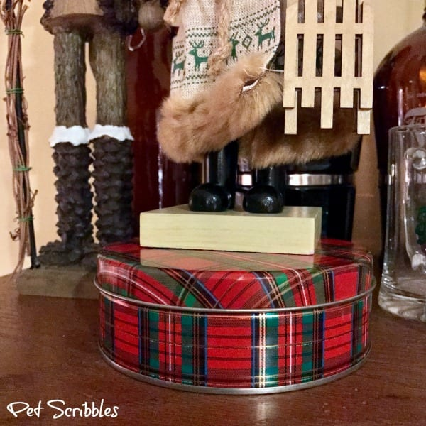 use cookie tins to elevate nutcrackers