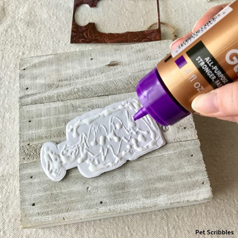 use glue to secure dimensional stickers to wood