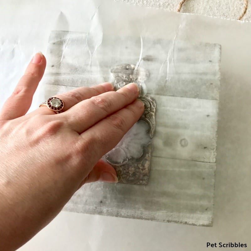 use wax paper to help press stickers in place